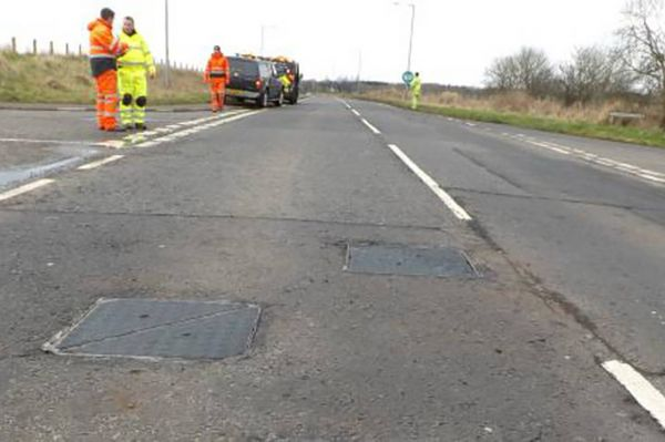 Preformed road markings making manhole covers safer